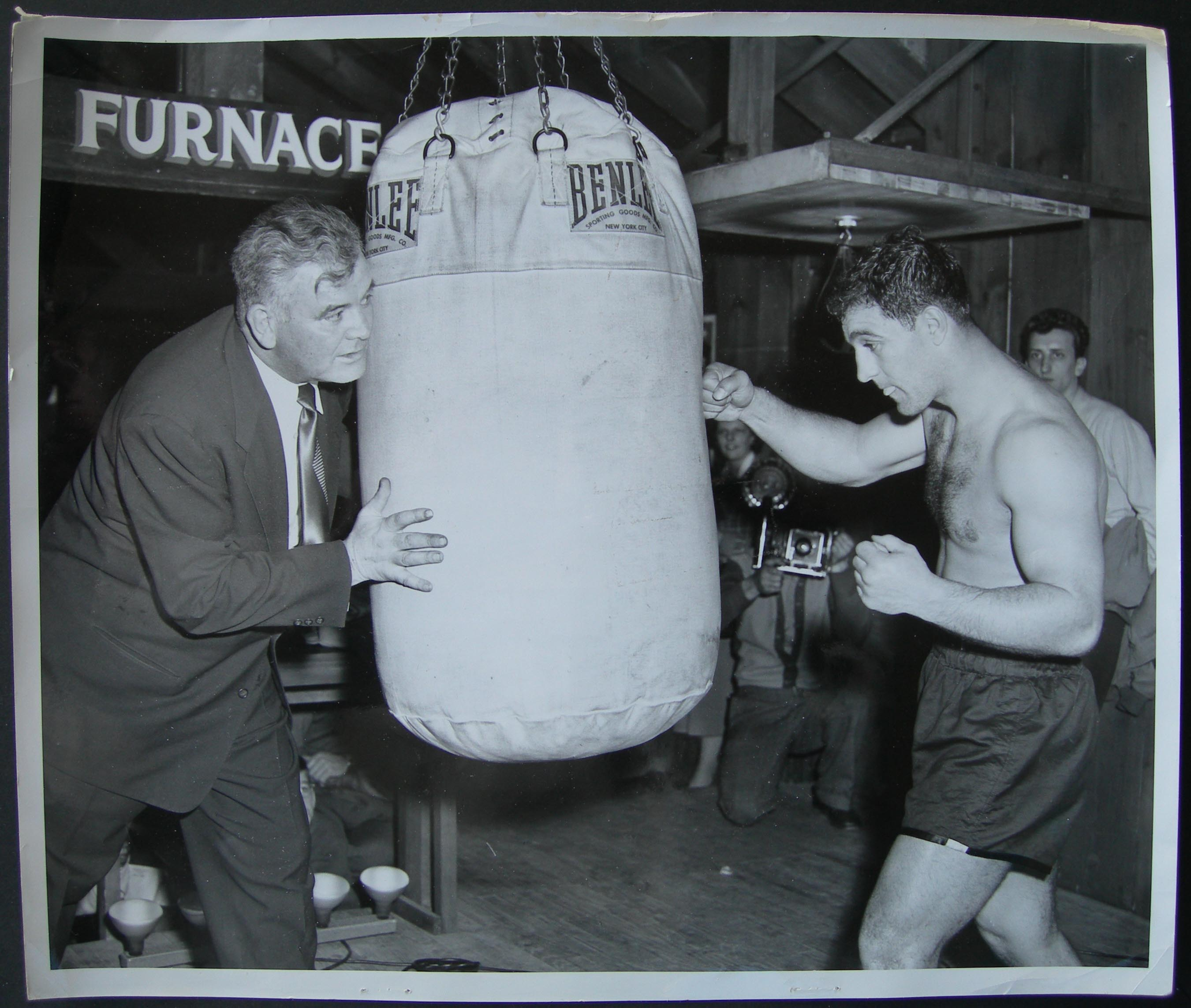 account of the boxing career of rocky marciano Boxer rocky marciano held the heavyweight boxing title for as a youngster rocky played baseball and football and dreamed of a professional career in one.